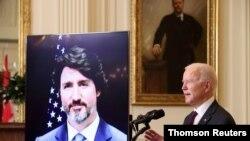 조 바이든 미국 대통령과 쥐스탱 트뤼도 캐나다 총리가 23일, 화상으로 첫 정상회담을 하고 있다.