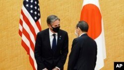 Japanese Prime Minister Yoshihide Suga, right, meets with U.S. Secretary of State Antony Blinken, left, during a courtesy call at the prime minister's official residence Tuesday, March 16, 2021. Defense and foreign ministers from the U.S. and Japan…