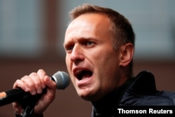 FILE - Russian opposition leader Alexei Navalny attends a rally to demand the release of jailed protesters in Moscow.