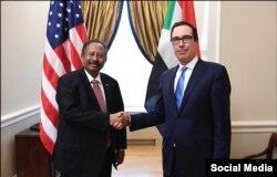 U.S. Treasury Secretary Steven Mnuchin, right,meets with Sudan's Prime Minister Abdalla Hamdok in Washington, Dec. 3, 2019.