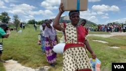 Food-insecure women leave a World Food Program relief center in Mudzi district, Zimbabwe, about 200 km east of Harare, Feb. 2020 (Columbus Mavhunga/VOA)