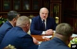 FILE - Belarusian President Alexander Lukashenko attends a meeting with top officials in Minsk, Jan. 26, 2021.