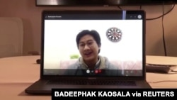 Thai medical student Badeephak Kaosala is seen on a computer screen as he speaks in an interview about being stranded in Wuhan, China, Jan. 27, 2020 in this still image taken from social media video. (Credit: Badeephak Kaosala)