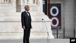 Italian singer Andrea Bocelli sings during a rehearsal outside the Duomo cathedral, on Easter Sunday, in Milan, April 12, 2020.