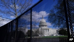FILE - The U.S. Capitol is seen behind security fencing in Washington, April 2, 2021. It was later removed, but law enforcement concerned about the prospect of violence at a D.C. rally in September plan to reinstall it, a source said.
