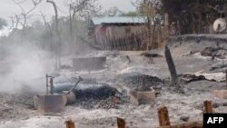 FILE - This handout photo from Pauk Township News taken and released June 16, 2021, shows the remains of houses allegedly set on fire by Myanmar junta forces, in Kin Ma village, Pauk township, in Myanmar's Magway region.