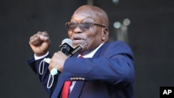 Former South African President Jacob Zuma, addresses supporters outside the High Court in Pietermaritzburg, South Africa, Wednesday May 26, 2021 where he faces charges of corruption. Zuma pleaded not guilty to corruption, racketeering, fraud.