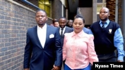 FILE - Bushiri (left) and his wife Mary walk into the court in South Africa. (Photo courtesy of 'Nyasa Times')