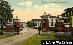 Postcard showing students guarding main entrance, Carlisle Industrial Indian School, Carlisle, Pa., ca. 1905.
