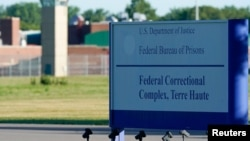 Signage is seen at a federal correctional complex as Daniel Lewis Lee, convicted in the killing of three members of an Arkansas family in 1996, is set to be put to death in the first federal execution in 17 years, in Terre Haute, Indiana, July 13, 2020.