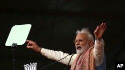 ນາຍົກລັດຖະມົນຕີ ອິນເດຍ ນາເຣນດຣາ ໂມດີ ກ່າວຖະແຫລງ ໃນການຊຸມນຸມ ຂອງພັກບາຣາຕີຢາ ຈານາຕາ ຮິນດູແຫ່ງຊາດຂອງທ່ານ ຫຼື້ BJP, ຢູ່ໃນນະຄອນຫຼວງນິວເດລີຂອງອິນເດຍ, ເມື່ອວັນອາທິດ ທີ 22 ທັນວາ 2019.