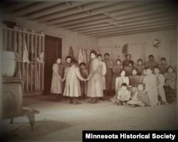 Children posed in an unknown Indian boarding school in Minnesota, ca. 1900.