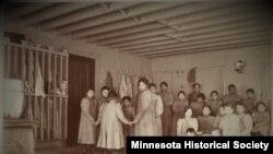 FILE - Children pose in an unidentified Indian boarding school in Minnesota, ca. 1900.