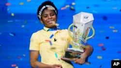 FILE - Zaila Avant-garde, 14, from Harvey, La., celebrates with the championship trophy after winning the finals of the 2021 Scripps National Spelling Bee at Disney World, July 8, 2021, in Lake Buena Vista, Fla.