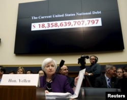 """FILE - Then-Federal Reserve Board Chair Janet Yellen closes her notes before testifying before the House Financial Services Committee on the """"Federal Reserve's Supervision and Regulation of the Financial System"""" in Washington Nov. 4, 2015."""