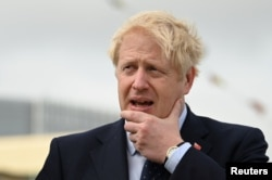 Britain's Prime Minister Boris Johnson visits the NLV Pharos, a lighthouse tender moored on the river Thames to mark London International Shipping Week in London, Britain, Sept. 12, 2019.