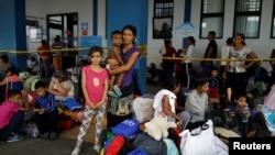 Refugiados venezolanos en Tumbes, Perú, esperando la tramitación de de documentos para continuar viaje en junio de 2019.