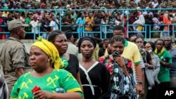 Mourners queue to pay their respects as the body of former president John Magufuli lies in state at Uhuru stadium in Dar es Salaam, Tanzania Saturday, March 20, 2021. Magufuli, a prominent COVID-19 skeptic whose populist rule often cast his country…