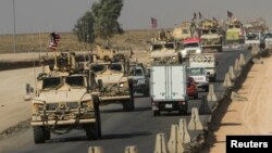 A convoy of U.S. vehicles is seen after withdrawing from northern Syria, on the outskirts of Dohuk, Iraq, Oct. 21, 2019.