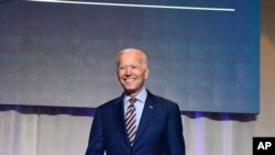 FILE - Former Vice President Joe Biden arrives on stage at the South Carolina Democratic Party convention, June 22, 2019 in Columbia, S.C..