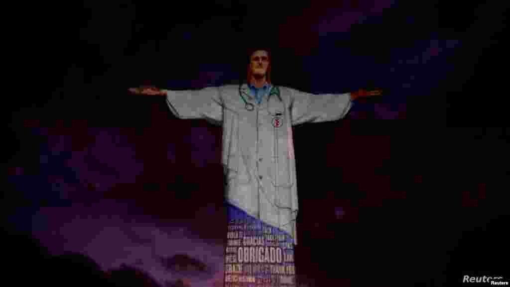 브라질 리우데자네이루 교구에서 부활절을 맞아 신종 코로나바이러스 감염증(COVID-19)과 사투를 벌이는 의료진을 기리기 위해 조명쇼를 기획한 가운데 리우데자네이루의 상징 예수상이 의사로 변신했다.