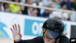 New Zealand's Olivia Podmore waves after competing at the Women's Sprint 1/8 finals at the Anna Meares Velodrome during the 2018 Commonwealth Games in Brisbane, Australia, April 6, 2018.