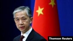 Phát ngôn viên Bộ Ngoại giao Trung quốc Uông Văn Bân tại một cuộc họp báo ở Bắc Kinh. (Reuters)