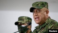 The commander of the Colombian Military Forces, Gen. Luis Fernando Navarro, speaks during a news conference about the alleged participation of several Colombians in the assassination of Haitian President Jovenel Moise, in Bogota, July 9, 2021.