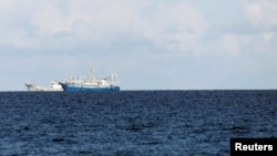 FILE - Chinese vessels are pictured in disputed South China Sea, April 21, 2017.