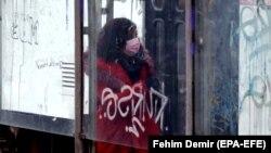 BOSNIA-HERZEGOVINA -- A woman wearing face mask walks on a street in the midst of the coronavirus disease (COVID-19) pandemic, in Sarajevo, December 18, 2020