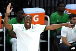Nigeria coach Mike Brown calls to the team during an exhibition basketball game against the United States on Saturday, July 10, 2021, in Las Vegas.
