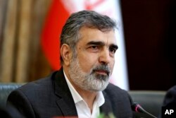 "Spokesman for Iran's atomic agency Behrouz Kamalvandi speaks in a press briefing in Tehran, Iran, Sunday, July 7, 2019. Iran's deputy foreign minister says that his nation considers the 2015 nuclear deal with world powers to be a ""valid document."""