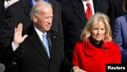 FILE - U.S. Vice President Joe Biden is sworn in as his wife Jill Biden watches during the inauguration of President Barack Obama in Washington, Jan. 20, 2009.