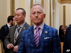 FILE - Rep. Jeff Van Drew of New Jersey departs after the House of Representatives voted to impeach President Donald Trump on two charges, abuse of power and obstruction of Congress, at the Capitol in Washington, Dec. 18, 2019.