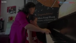 Four-year-old Girl Became Piano Player in One Year