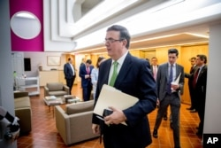 Mexican Foreign Affairs Secretary Marcelo Ebrard arrives for a news conference at the Mexican Embassy in Washington, Tuesday, June 4, 2019, as part of a Mexican delegation in Washington for talks.