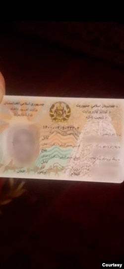 """There are two types of national identification cards in Afghanistan. This is a recent one that states the ethnicity of Uyghurs as """"Uyghur."""" (Abdulaziz Naseri)"""