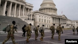 Members of the National Guard arrive to the U.S. Capitol days after supporters of U.S. President Donald Trump stormed the Capitol in Washington, D.C. (Reuters)