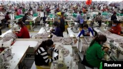 In this file photo taken on Dec. 12, 2018, employees work at a factory supplier of the H&M brand in Kandal province, Cambodia.
