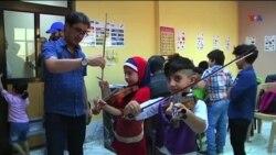 İraqlı uşaqlar musiqidə pənah tapır