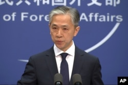 Chinese foreign ministry spokesman, Wang Wenbin, speaks during a press conference where he congratulated U.S. president-elect Joe Biden.