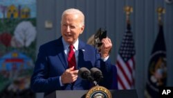 President Joe Biden speaks to school staff during a visit at Brookland Middle School in northeast Washington, Sept. 10, 2021.