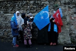 Ethnic Uighur women are seen during a protest against China near the Chinese Consulate in Istanbul, Turkey, Dec. 15, 2019.