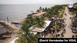 The Colombian port town of Necoclí is a transit point for migrants aiming to cross the Gulf of Uruba to Capurganá, another Colombian town. From there, many attempt a difficult trek through Panama's Darien Gap. (David Hernández/ VOA)