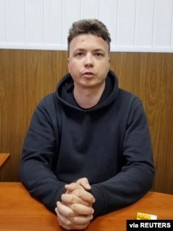 FILE - Belarusian blogger Raman Pratasevich is said to be seen in a pre-trial detention facility in Minsk, Belarus May 24, 2021, in this still image taken from video. (Telegram@Zheltyeslivy/Reuters TV)