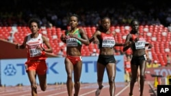FILE - (L to R) Bahrain's Mimi Belete, Ethiopia's Genzebe Dibaba, Kenya's Mercy Cherono and Kenya's Irene Chepet Cheptai, compete in the women's 5000m at the World Athletics Championships at the Bird's Nest stadium in Beijing, China, Aug. 27, 2015.