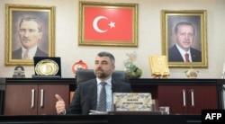 FILE - Faruk Kilic, city chairman for Turkish President Recep Tayyip Erdogan's ruling party, speaks during a interview in Mardin, Turkey, Feb. 25, 2020.