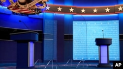 Clear protective panels stand on stage between lecterns for President Donald Trump and Democratic presidential candidate, former Vice President Joe Biden, ahead of their debate at Belmont University, in Nashville, Tennessee, Oct. 21, 2020.
