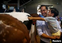 Democratic 2020 U.S. presidential candidate and former HUD Secretary Julian Castro and his son Cristian tour the Iowa State Fair in Des Moines, Iowa, Aug. 9, 2019.
