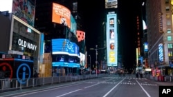 Seventh Avenue is mostly empty during what would normally be a Times Square packed with people, Dec. 31, 2020, in New York, as celebrations were truncated this New Year's Eve because of the ongoing pandemic.